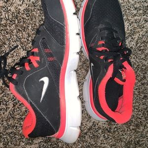 Black and pink nike shoes